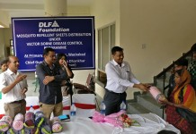 Mr. Ritesh Sinha,Director-CSR, DLF Foundation distributing the sheets.