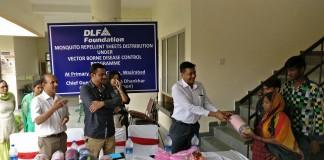 Mr. Ritesh Sinha,Director-CSR, DLF Foundation distributing the sheets.