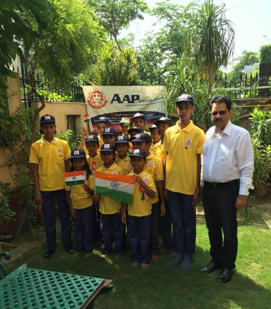 Mr. Mahesh Chand Sharma, Chairman, AAP International with Underprivileged Childern
